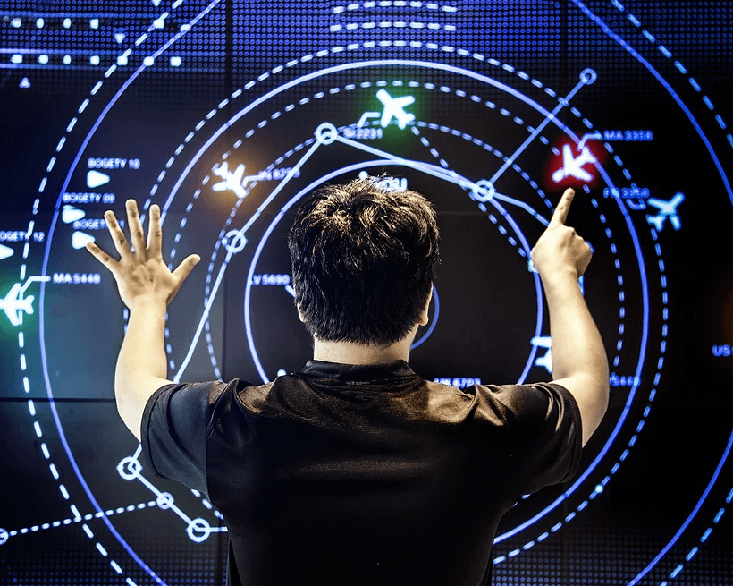 Flight technician in front of AI board showing positions of aircraft
